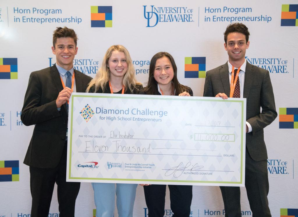 Receiving their $11,000 check for first place, four members of the Elix team represented their start-up at the Diamond Challenge.