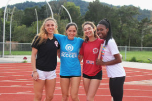 Nava Kohn, far right, smiles with her relay team.