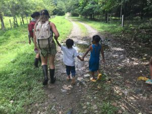 Slaugh walking with kids from Panama