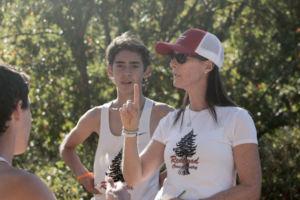 Coach Laura Schmitt congratulating the boys after their race