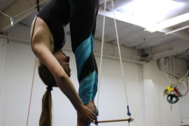 Stretching for her toes, senior Emma Ross aerial dances each week.