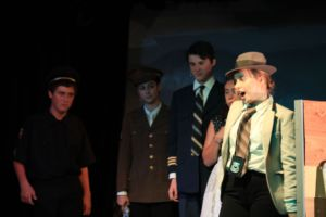 Maggie Anglin, playing Lieutenant Harper, with GiGi Buddie, Jake Hanssen, Amira Jain and Jackson Beer, sings Whole Lotta Man