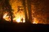 A firefighter battles a raging fire in Northern California.