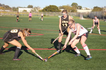 Sophomore Eva Oppenheim steals the ball from an opponent.