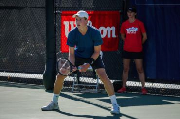 Junior Stevie Gould preparing to return a serve in the Tiburon Challenger