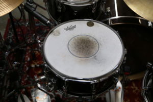 Camden's beat up drum from hours of practicing.