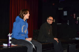 Junior Lily Derecktor and teacher Peter Parish discussing the upcoming lip dub.