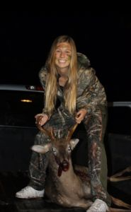 Sophomore Delaney Anderson holds up a recent kill. Her family either consumes or donates all of the meat they hunt.