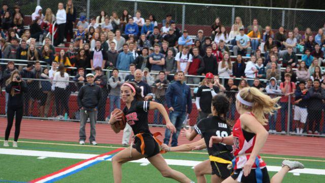 Senior Hannah Halford runs down the sideline towards the endzone