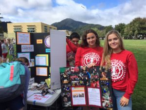 Leah Gustafson and other club leaders at the Interact table during club day.