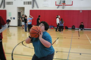 Aiming for the hoop, a player shoots the ball