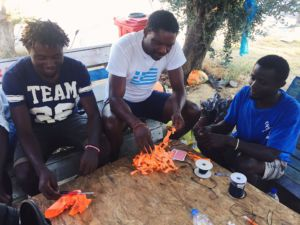 The Syrian refugees on the island of Lesbos, Greece are making bracelets out of lifejacket material.