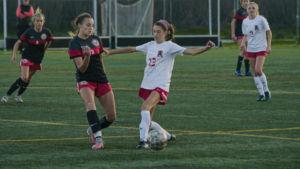 Junior Maddie Perro evades a defender