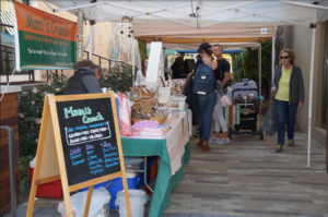 Farmers market runs through Corte Madera, town center mall selling fresh fruits and vegetables.