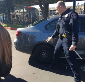 CHP officer comes to school to show the club how to change a tire. (Courtesy of Natalie Veto)
