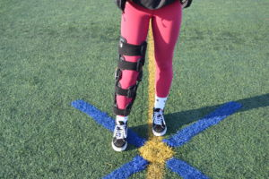 McGonigle wears a brace to protect her knee from any further injuries.