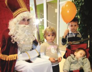 Junior Luis Schmidt Minestrelli at age 8 (holding the balloon) and his siblings meeting Saint. Nicholas in their hometown of Chaumont-Gistoux, Belgium.