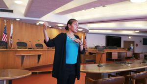 Wendy Pacheco swears in new members of YLI as members of county government.