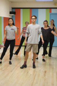 Leading the group at the front of the class, freshman John O'Neal plans on continuing to dance and perform for as long as he can.