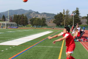Junior Justin Neustaetter chucks the ball in a Redwood throw-in