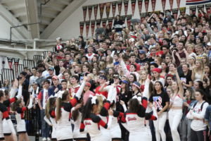 Cheering for their team, Redwood students wear red, white, and blue to support the USA theme,