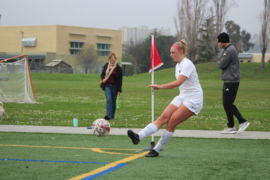 #5 Sophia Curtaz strikes a corner kick in the first half