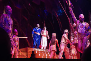 Mid musical number, Aladdin (right) as played by Adam Jacobs and Genie (left) played by James Monroe Iglehart sing passionately.