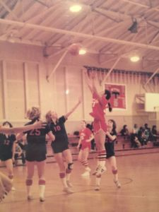 Shooting the ball during a game, Caren's picture sits in the Redwood Alumni Hall of Fame for her many athletic accomplishments.