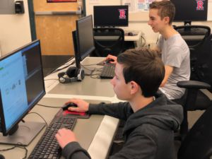 Coding in lab 279, Bennett Somerville and Ethan Davis, focus closely on the screen.