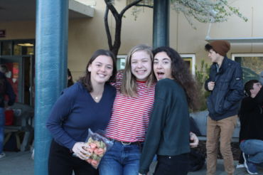 Senior Leadership students Luna Zirpoli, Amelia Shunk and Jacqueline Massey-Blake (from left to right) pose, ready to hand out fortune cookies.