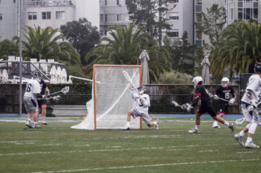 Sophomore Evan Stephens launching the ball for a goal