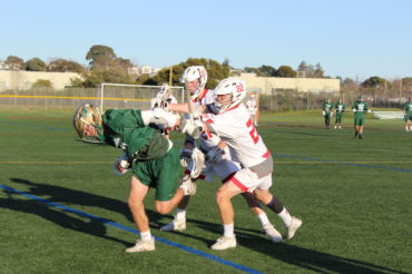 Teaming up on defense, Redwood players force an opponent out of bounds.