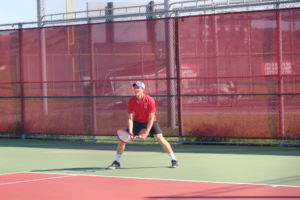 Junior Stevie Gould prepares for his opponents serve