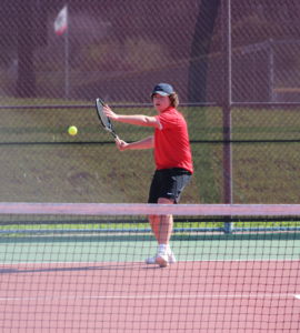 Sophomore David Tierney returns his opponents serve