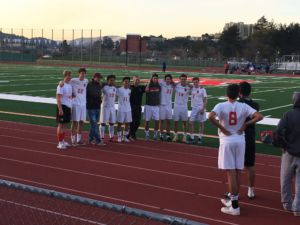 Posing for a team photo, the varsity boys gear up to play Richmond in the NCS semi-finals.