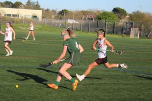 Freshman Keegan Seamless chases down the ball late in the first half