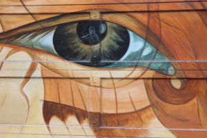 The horrors of war haunt many children, as this mural reminds viewers, and although the image is reflected in the child's eyes temporarily, the memory will last forever.