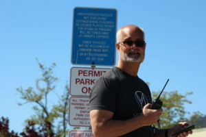 Scott Morgan, the campus staff assitant, escorted the protesters from the front parking lot to ensure their safety.