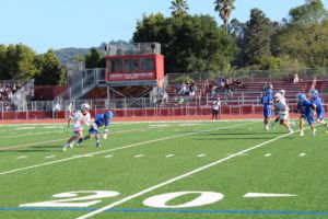 Running past his defender, junior Zach Toma looks to attack the goal