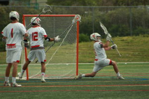 Junior goalie Talis Stockton reaches to block a shot made by SI.