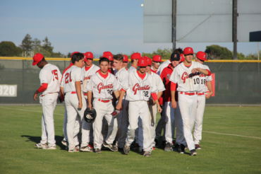 Redwood's team walks back to the dugout after a disheartening game.