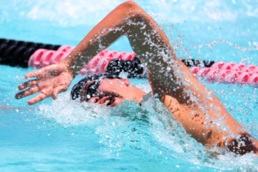 Redwood High School's Ivan Kurakin races to a fourth place finish in the Boys 500 Yard Freestyle during the 2018 NCS Swimming and Diving Championship Meet on Saturday, May 12, 2018, in Livermore, Calif.  (Aric Crabb/Bay Area News Group)