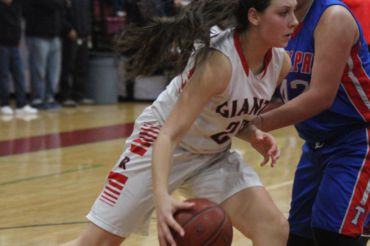 Dribbling past her opponent, Stachowski defensive skills attribute immensely to the varsity team.