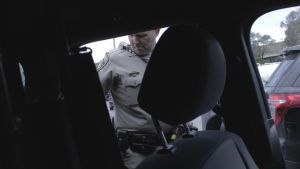 Officer Barclay (CHP) packs his patrol car with his kit for the day