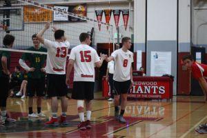 Jacob Zimmerman high-fiving a teammate.