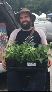 Avocado farmer Chris Krump holds his beloved plants
