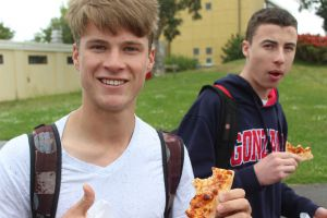 Senior Zach Tull  enjoys a slice of Stefano's pizza at lunch on campus during Sustainability Week.