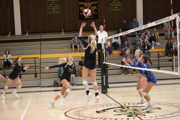 Junior Lucy Walsh sets up  teammate Elsa Kemp for a spike.