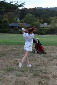 Senior Captain Nina Cinelli hits her ball out of the weeds.