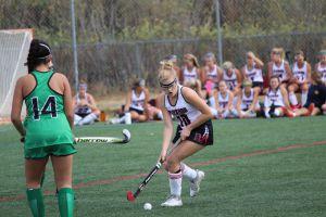 Senior Caroline Soja jukes out Drake defender and looks for an open teammate